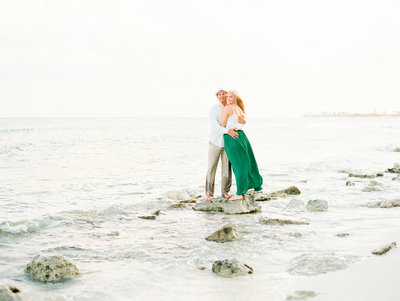 couple engaged on the beach light and airy background