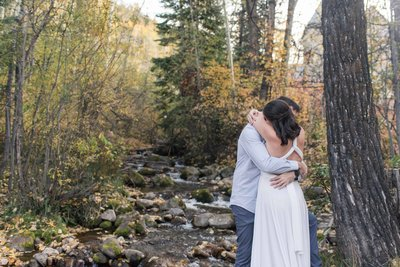 Houston couple eloping in Avon Colorado in fall near river. Texas elopement photographer captures their entire day.