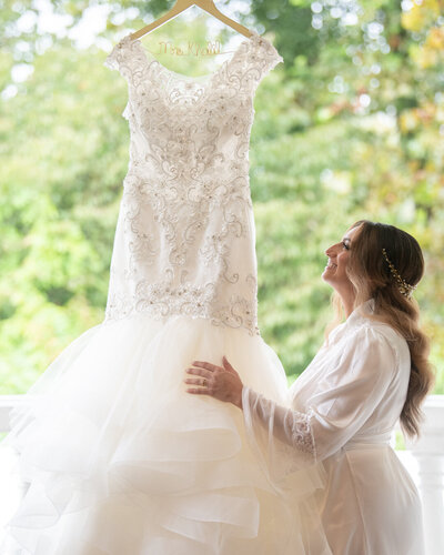 a bride looking at her wedding dress