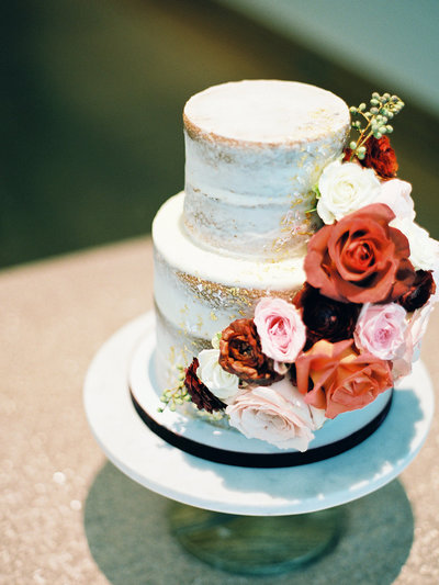 Naked wedding cake with florals and gold leaf | art museum wedding