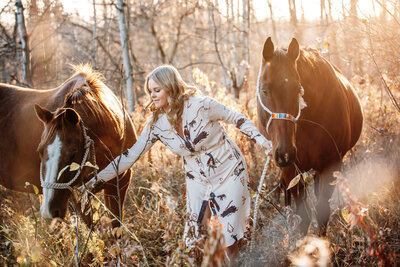 girl with 2  quarter horses