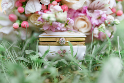 beautiful detail photo of engagement ring with fresh flower bouquet