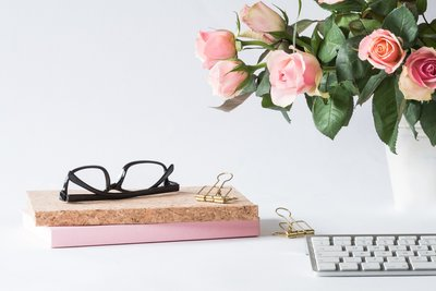 eyeglasses-on-book-beside-rose-and-keyboard-2008143 copy