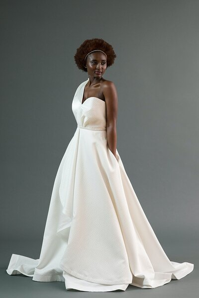 Photo link to more details about the Kimi wedding dress with its asymmetrical neckline