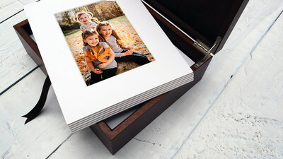 Heirloom box of matted printed photographs