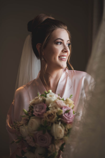 Beautiful bride getting ready with soft light