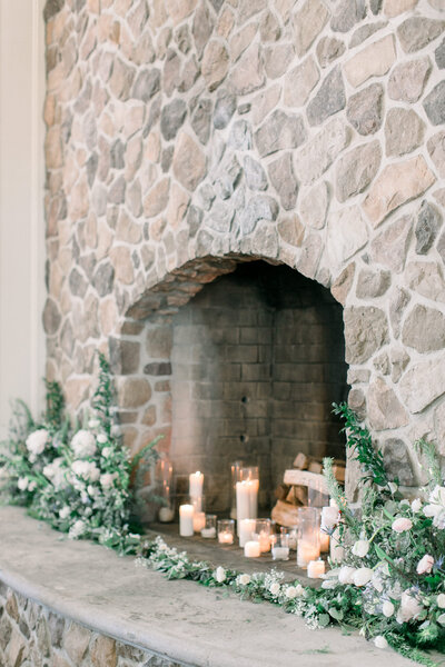 hearth with candles and white flowers