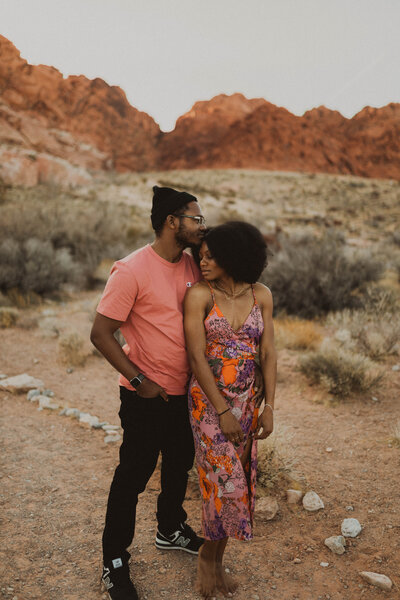 Couple in the desert holding each other