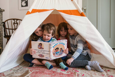 kids reading in a tipi