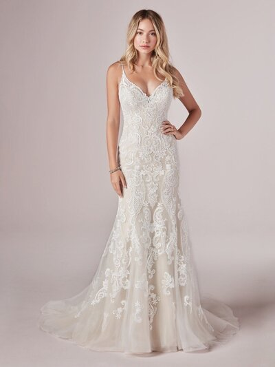 Mermaid Wedding Dress. Go full beach mode in this romantic mermaid wedding dress. (Even the lace motifs look like seashells and sunset waves!)