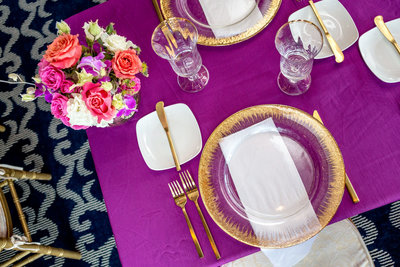 Purple and gold tablescape at an Ocean Club wedding