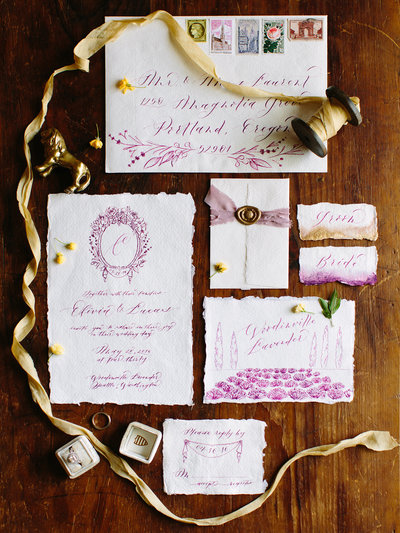 Purple wedding invitation suite flat lay