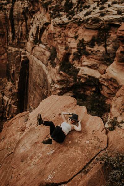 woman laying on cliff