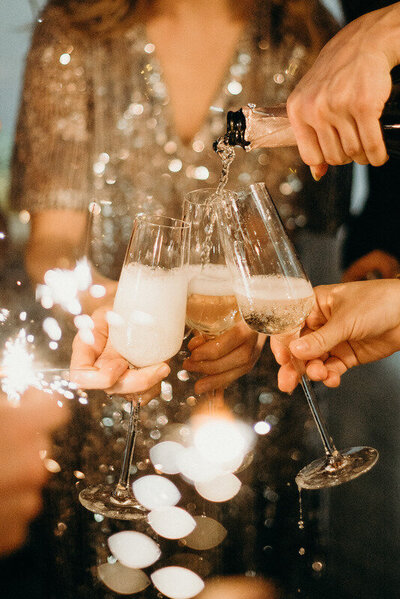 Canva - Person Pouring Champagne on Champagne Flutes (1)