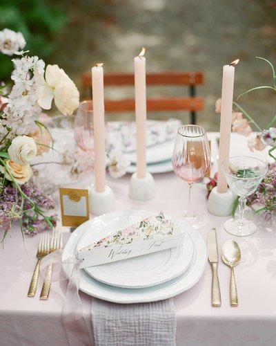 Wedding reception place steting with candles and copper cutlery