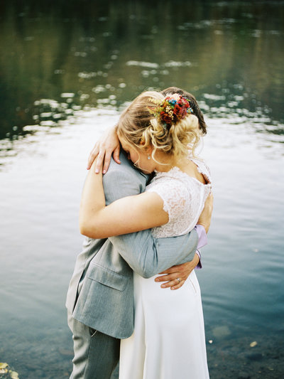 Bride and Groom standing together hugging in a warm embrace overlooking Mexican Mayan cenote