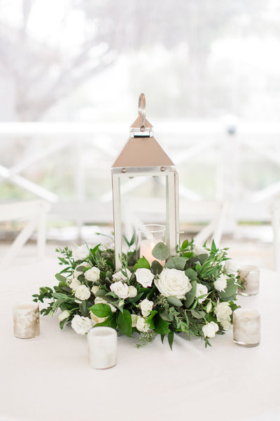 Lantern with floral wreath