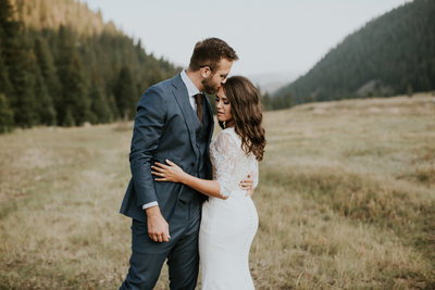 320 Guest Ranch Big Sky MT Wedding Couple Embracing