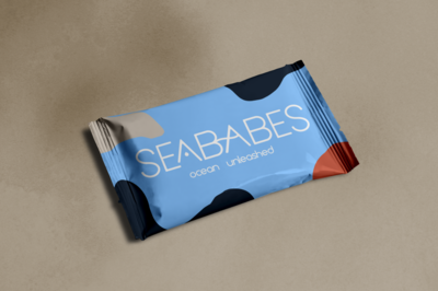 blue and orange snack packaging made for SeaBabes. Packaging design done by Ile Alafia Design Co.