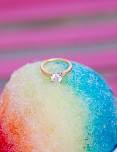 wedding ring on top of a snow cone