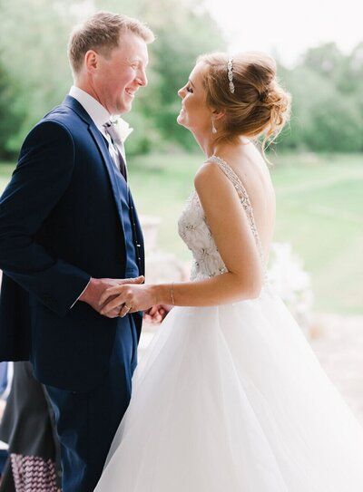 Soft and romantic light and airy  image of bride and groom saying their vows