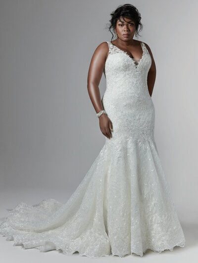 Gorgeous ruffles and lace combine in this classically beautiful bridal look.