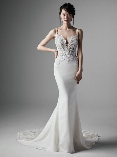 Crepe Sheath Wedding Dress. What's your brand of glam? Your sultriest of statements? Your chicest confidence booster? Play up your best assets in this sexy + unique sheath crepe wedding dress.