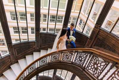 Wedding photo at the iconic Rookery staircase in Chicago.