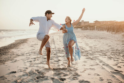 Couple dances down the beach