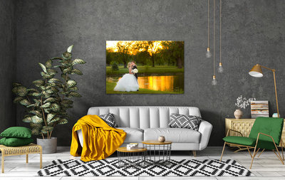 Large framed wedding photo on a gray wall in a living room.