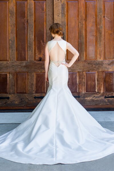 Back view of the Eva wedding dress's keyhole back and long train from the Classics bridal collection