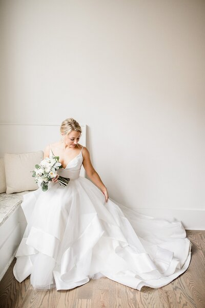 Bride sitting in wedding gown by Knoxville Wedding Photographer Amanda May Photos