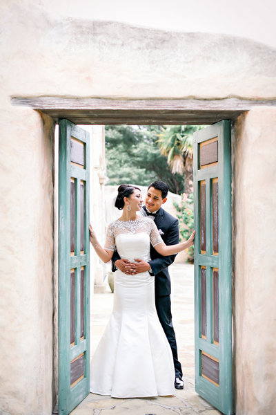 husband and wife embracing by door