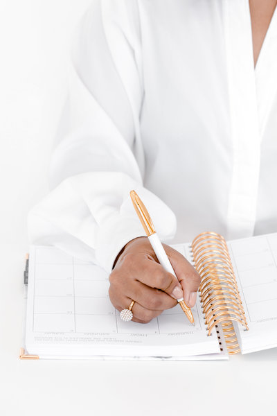 stock photo - woman writing in planner