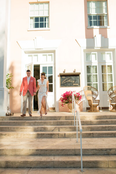 Bride and groom exit  their intimate dinner reception at The Colony Palm beach
