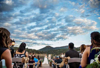 Gorgeous-Sunset-Wedding-Ceremony-on-Deck-at-Evergreen-Lake-House-in-Colorado