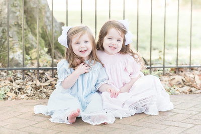 southern girls in blue and pink smocked dresses