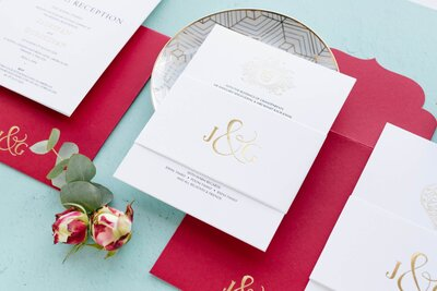Royal red and gold foil invitation suite