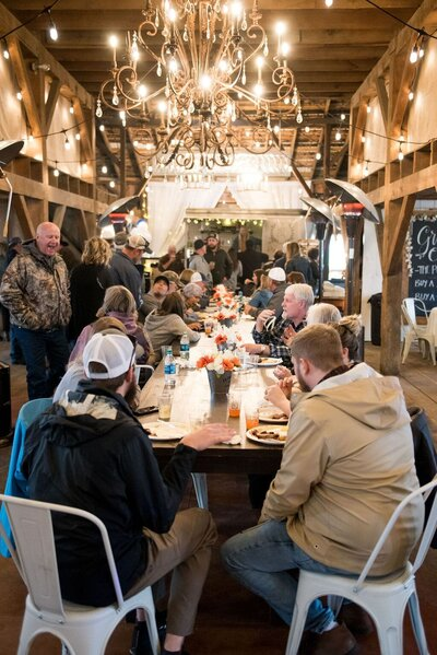 community dinner at barn venue