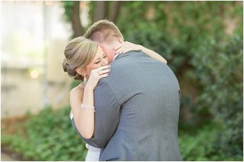 bride and groom embrace at Twigs garden wedding