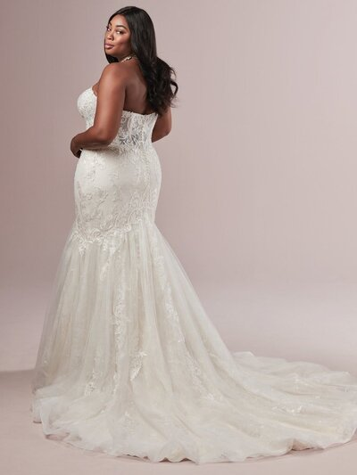 Crystal beadwork and delicate appliques cover this strapless fit and flare gown.