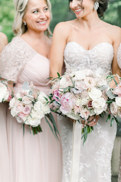 Bride and bridesmaids with bouquet at Napa wedding