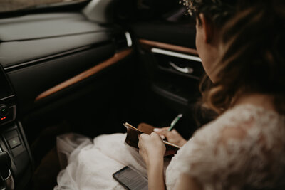 bride writing in the car