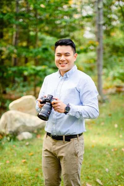 Alex holding video camera for New Hampshire weddings