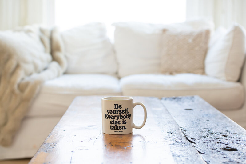 Oscar wild quote mug on living room table