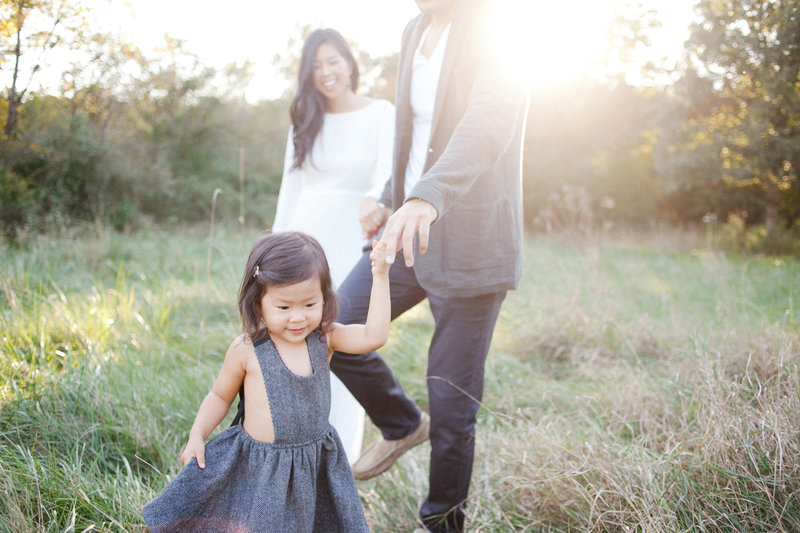 Gorgeous natural light family session outdoors during sunset with Laurie Baker