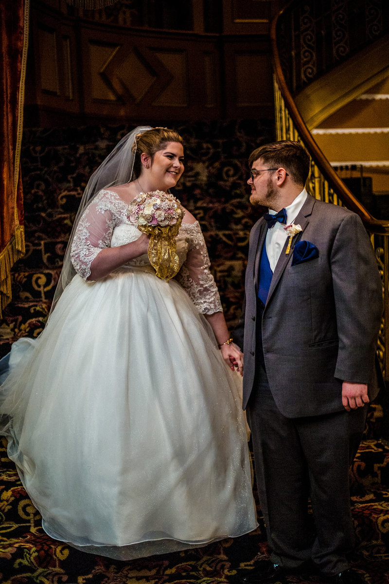 Groom sees bride for the first time at the Warner Theatre