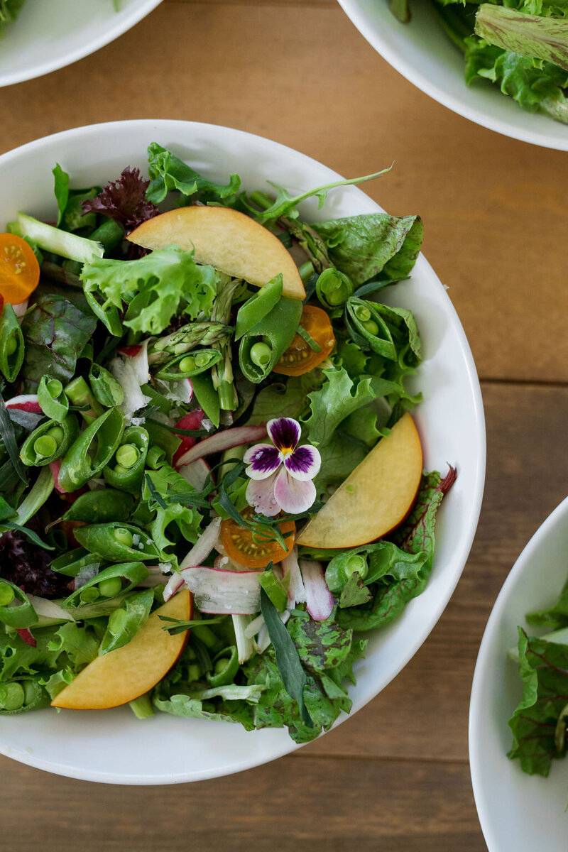 green salad with nectarines and flowers