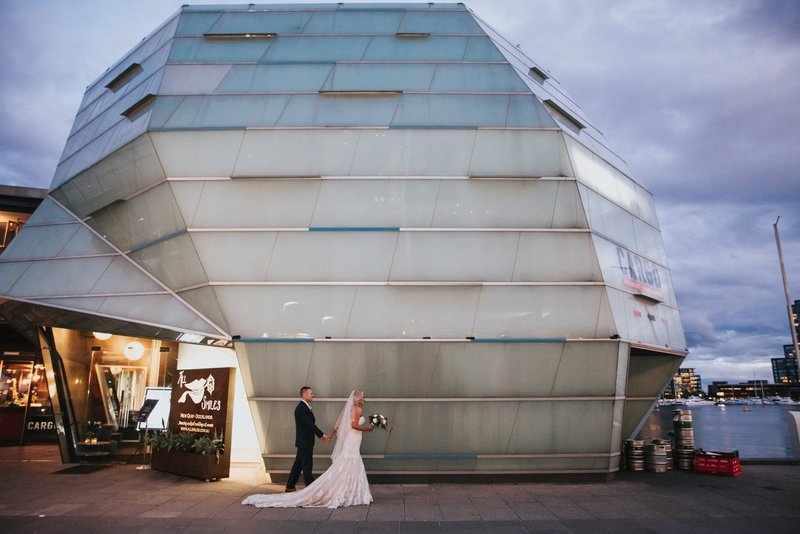 Bride and Groom walking through Melbourne City during Bridal Portraits
