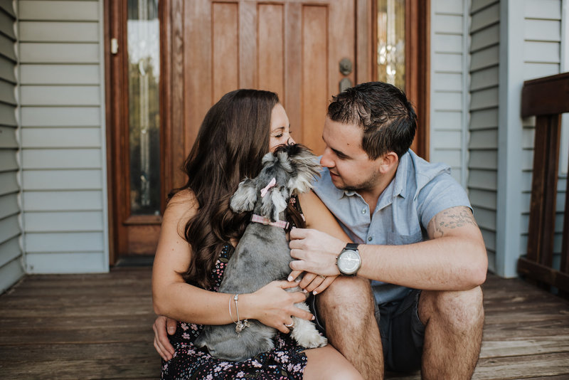 couple sitting on porch with dog